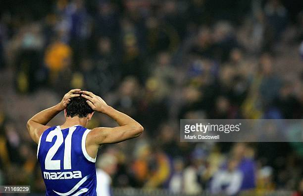 Corey Jones of the Kangaroos holds his head after the clubs loss in the round eleven AFL match between the Richmond Tigers and the Kangaroos at the...