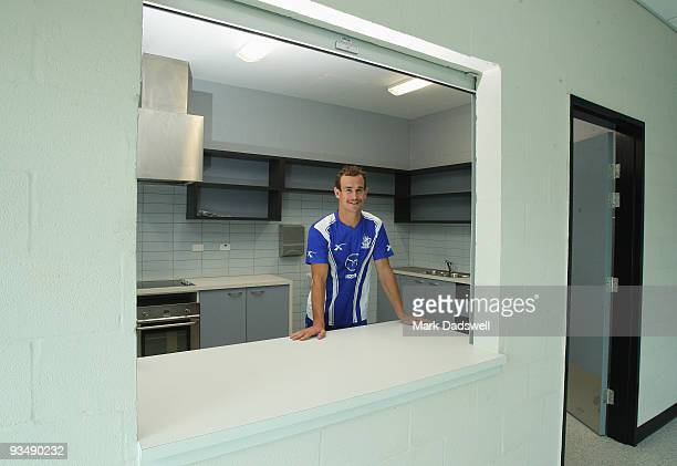 Corey Jones of the Kangaroos inspects kitchen facilities in the clubs new training educational and administration complex at Arden Street on November...