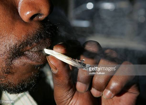 Corey Kelly who is HIV positive smokes medicinal marijuana at the Alternative Herbal Health Services cannabis dispensary July 13 2006 in San...
