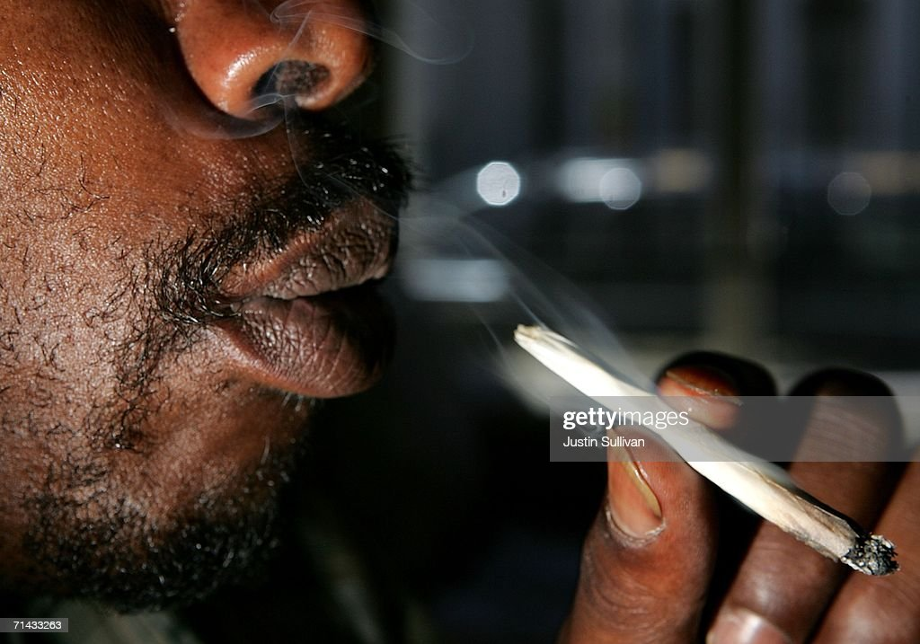 Corey Kelly, who is HIV positive, smokes medicinal marijuana at the Alternative Herbal Health Services cannabis dispensary July 13, 2006 in San Francisco. San Francisco city planners are deciding July 13 if they will issue a permit to allow Kevin Reed to open the Green Cross medical marijuana dispensary right in the middle of San Francisco's Fisherman's Wharf area, a popular tourist destination.