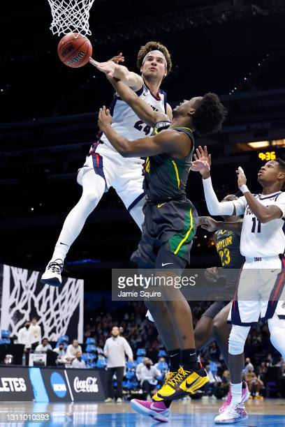 Corey Kispert of the Gonzaga Bulldogs blocks a shot by Adam Flagler of the Baylor Bears in the National Championship game of the 2021 NCAA Men's...