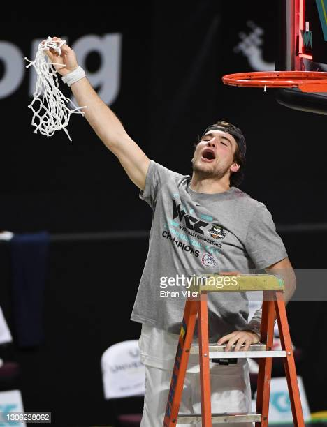 Corey Kispert of the Gonzaga Bulldogs celebrates after cutting down a net following the team's 88-78 victory over the Brigham Young Cougars to win...