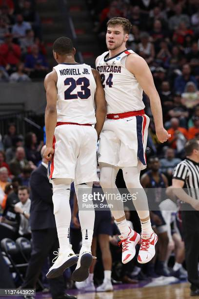 Corey Kispert of the Gonzaga Bulldogs celebrates with teammate Zach Norvell Jr #23 against the Fairleigh Dickinson Knights during the first half in...