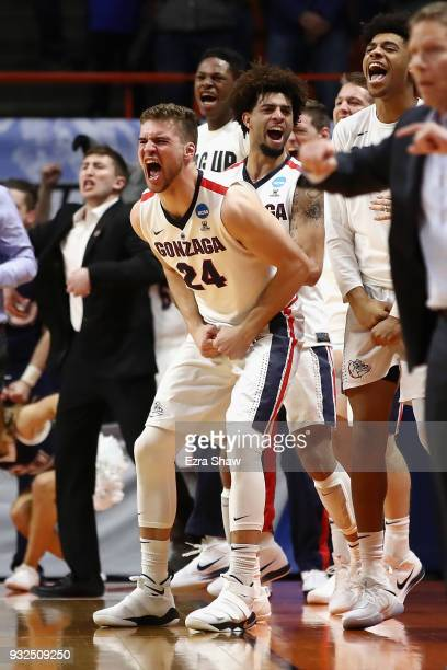 Corey Kispert of the Gonzaga Bulldogs celebrates with teammates in the second half against the UNCGreensboro Spartans during the first round of the...
