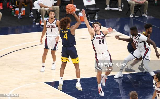 Corey Kispert of the Gonzaga Bulldogs defend the shot of Miles McBride of the West Virginia Mountaineers during the Jimmy V Classic at Bankers Life...
