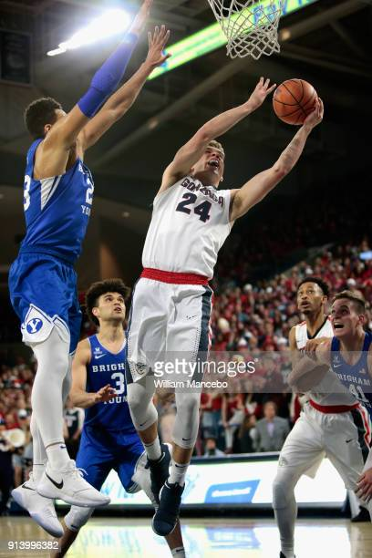 Corey Kispert of the Gonzaga Bulldogs goes to the basket against Yoeli Childs of the BYU Cougars in the second half at McCarthey Athletic Center on...
