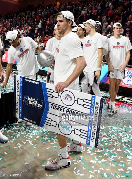 Corey Kispert of the Gonzaga Bulldogs holds the trophy and a ceremonial NCAA tournament ticket after the Bulldogs defeated the Saint Mary's Gaels...
