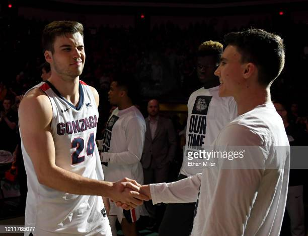 Corey Kispert of the Gonzaga Bulldogs is greeted on the court by Matthew Lang during player introductions before taking on the Saint Mary's Gaels in...
