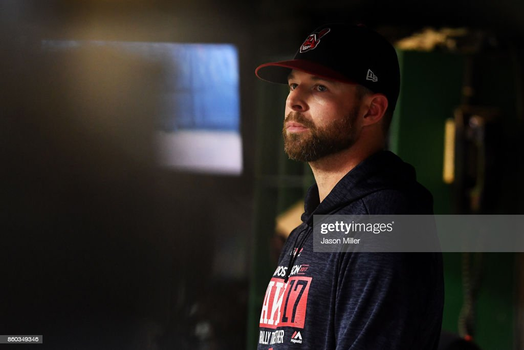 Corey Kluber #28 of the Cleveland Indians looks on from the dugout in the eighth inning against the New York Yankees in Game Five of the American League Divisional Series at Progressive Field on October 11, 2017 in Cleveland, Ohio.