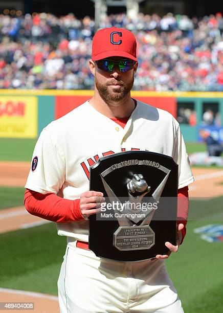 Corey Kluber of the Cleveland Indians poses for a photo after receiving his 2014 Cy Young Award prior to the Opening Day Game against the Detroit...