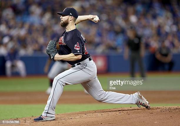 Corey Kluber of the Cleveland Indians throws a pitch in the first inning against the Toronto Blue Jays during game four of the American League...