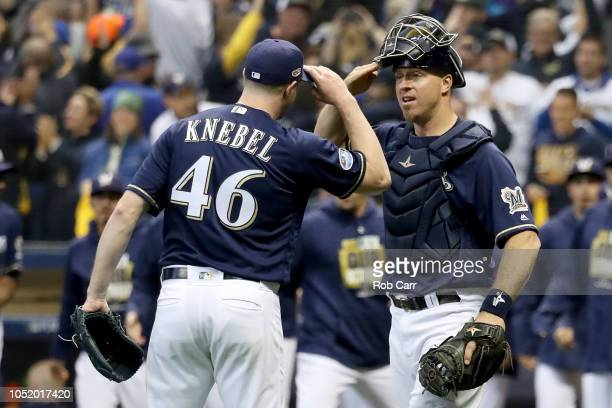 Corey Knebel and Erik Kratz of the Milwaukee Brewers celebrate after defeating the Los Angeles Dodgers in Game One of the National League...