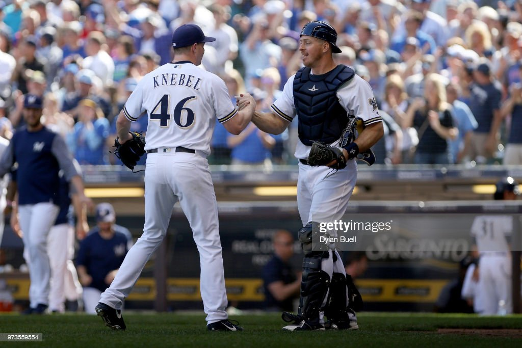 Corey Knebel #46 and Erik Kratz #15 of the Milwaukee Brewers celebrate after defeating the Chicago Cubs 1-0 at Miller Park on May 27, 2018 in Milwaukee, Wisconsin.