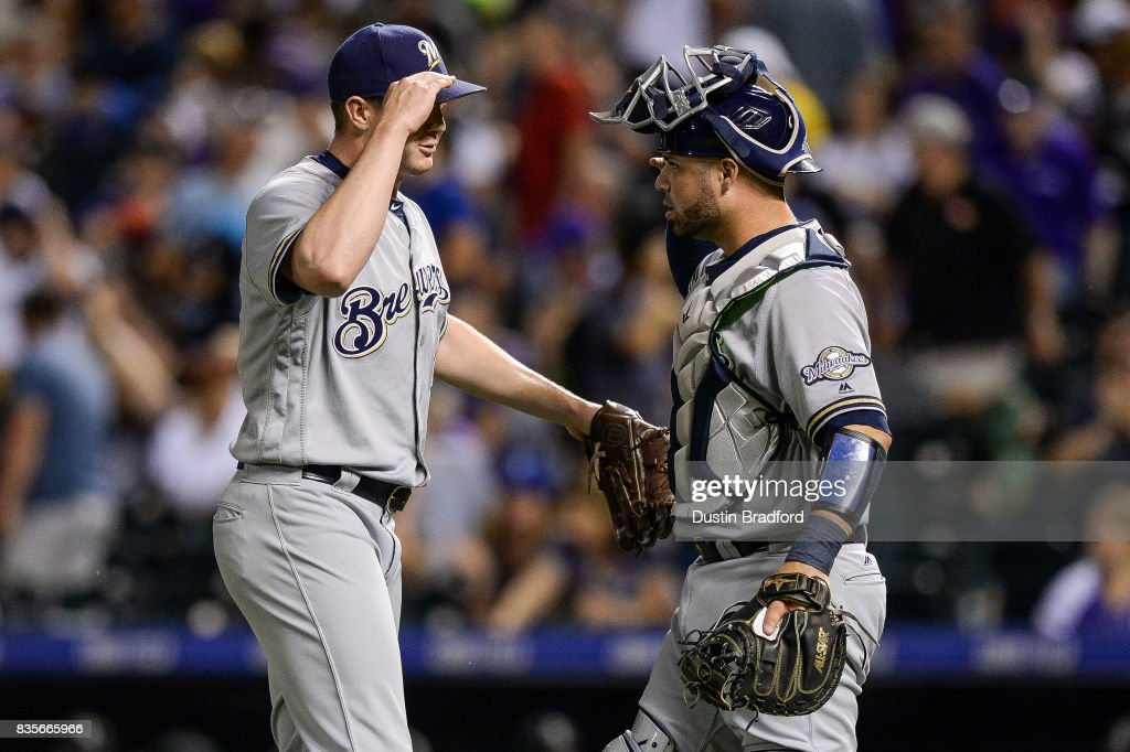 Corey Knebel #46 and Manny Pina #9 of the Milwaukee Brewers celebrate a 6-3 win over the Colorado Rockies at Coors Field on August 19, 2017 in Denver, Colorado.