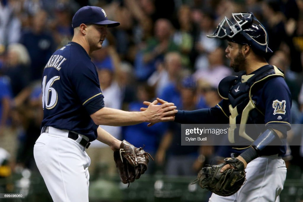 Corey Knebel #46 and Manny Pina #9 of the Milwaukee Brewers celebrate after beating the Pittsburgh Pirates 4-3 at Miller Park on June 21, 2017 in Milwaukee, Wisconsin.