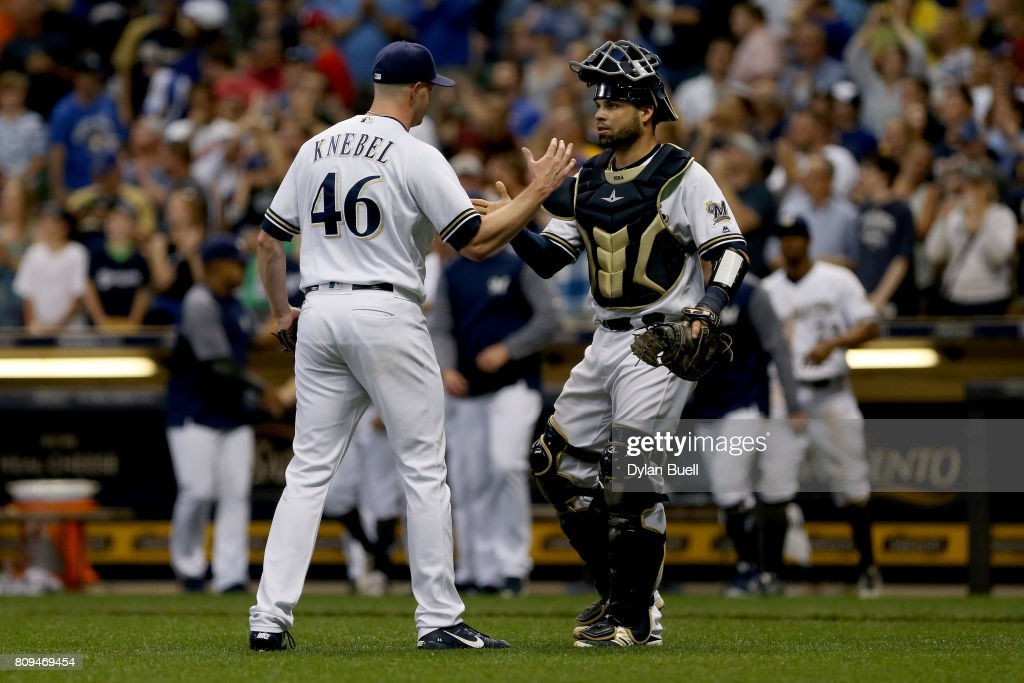Corey Knebel #46 and Manny Pina #9 of the Milwaukee Brewers celebrate after beating the Baltimore Orioles 4-0 at Miller Park on July 5, 2017 in Milwaukee, Wisconsin.