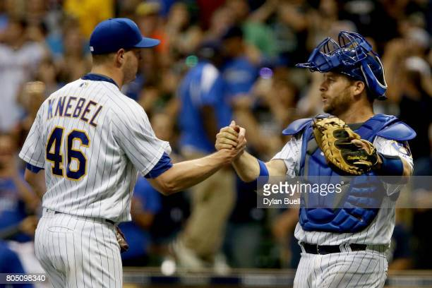 Corey Knebel and Stephen Vogt of the Milwaukee Brewers celebrate after beating the Miami Marlins 32 at Miller Park on June 30 2017 in Milwaukee...