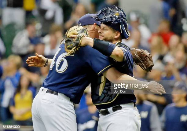 Corey Knebel of the Milwaukee Brewers and Stephen Vogt hug after their win over the Washington Nationals at Miller Park on August 31 2017 in...
