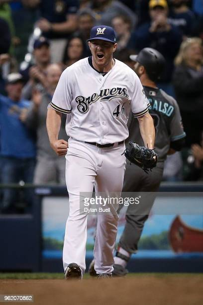 Corey Knebel of the Milwaukee Brewers celebrates after beating the Arizona Diamondbacks 10 at Miller Park on May 22 2018 in Milwaukee Wisconsin