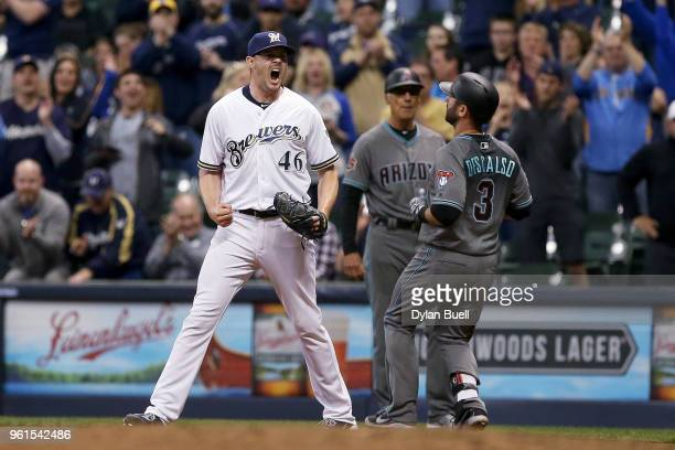 Corey Knebel of the Milwaukee Brewers celebrates after Daniel Descalso of the Arizona Diamondbacks grounded out to end the game to give the Milwaukee...