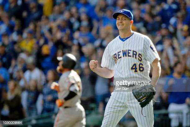 Corey Knebel of the Milwaukee Brewers celebrates after Hunter Pence of the San Francisco Giants flew out for the final out of the game at Miller Park...