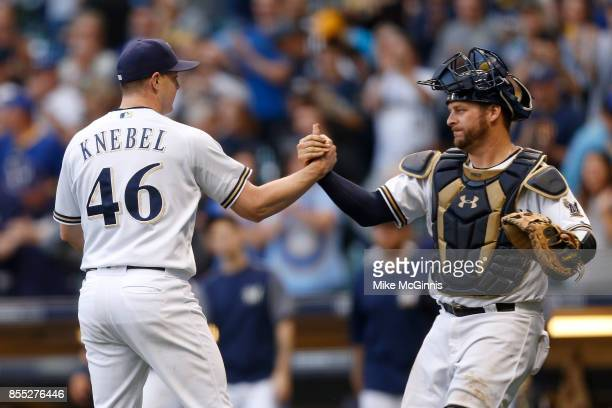 Corey Knebel of the Milwaukee Brewers celebrates with Stephen Vogt after the 43 win over the Cincinnati Reds at Miller Park on September 28 2017 in...