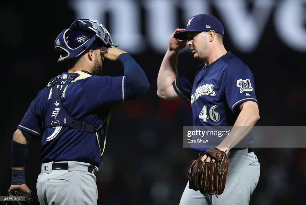 Corey Knebel #46 of the Milwaukee Brewers celebrates wth Manny Pina #9 after they beat the San Francisco Giants at AT&T Park on August 22, 2017 in San Francisco, California.