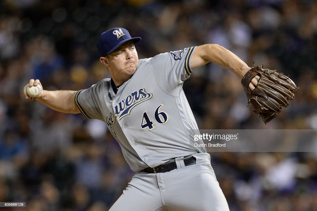 Corey Knebel #46 of the Milwaukee Brewers pitches in the ninth inning of a game against the Colorado Rockies at Coors Field on August 19, 2017 in Denver, Colorado.