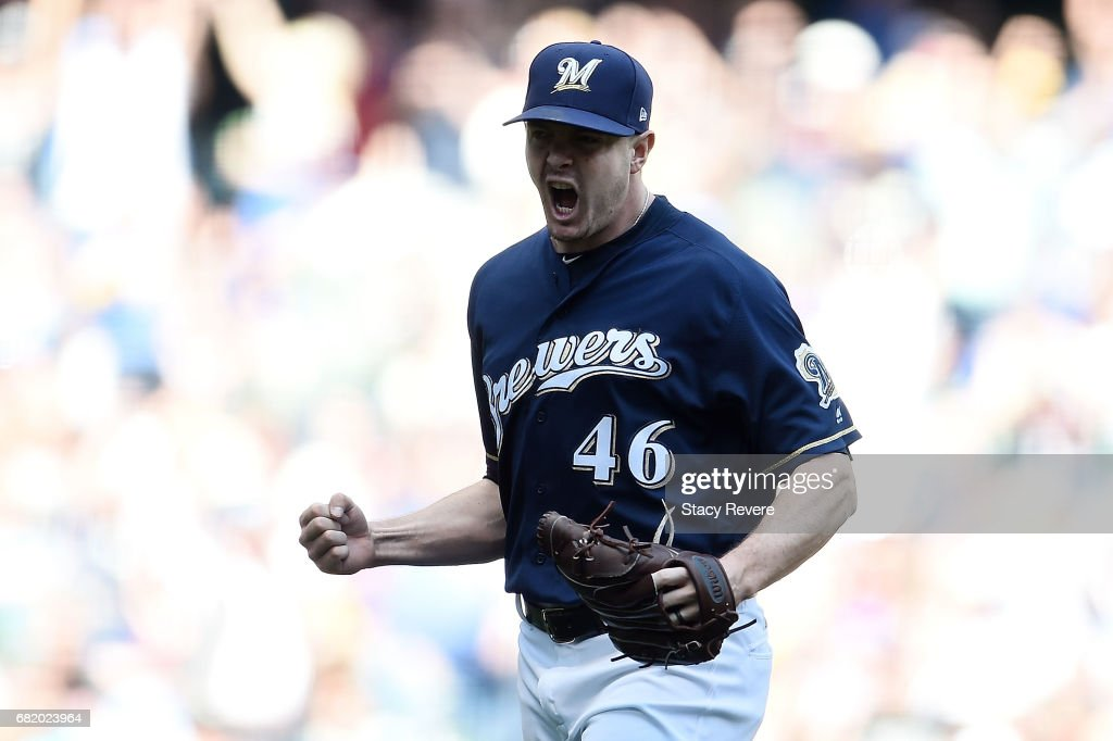 Corey Knebel #46 of the Milwaukee Brewers reacts to a strike out during the eighth inning of a game against the Boston Red Sox at Miller Park on May 11, 2017 in Milwaukee, Wisconsin.