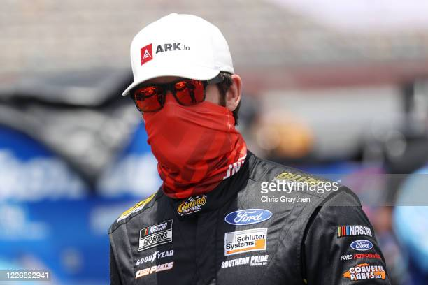 Corey LaJoie driver of the ARKio Ford walks the grid during qualifying for the NASCAR Cup Series CocaCola 600 at Charlotte Motor Speedway on May 24...