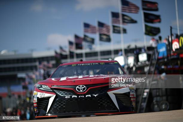 Corey LaJoie driver of the Dr Pepper Toyota drives through the garage area during practice for the Monster Energy NASCAR Cup Series AAA Texas 500 at...