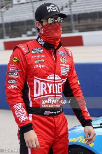 Corey LaJoie driver of the Drydene Ford stands on pit road prior to the NASCAR Cup Series The Real Heroes 400 at Darlington Raceway on May 17 2020 in...
