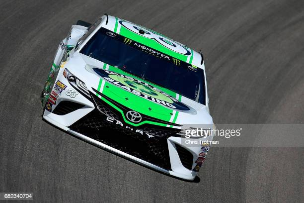 Corey LaJoie driver of the Dustless Blasting Toyota practices for the Monster Energy NASCAR Cup Series Go Bowling 400 at Kansas Speedway on May 12...