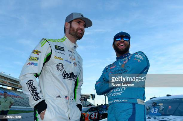 Corey LaJoie driver of the Gas Monkey Garage Chevrolet and Bubba Wallace driver of the NASCAR Racing Experience Chevrolet talk on the grid during...