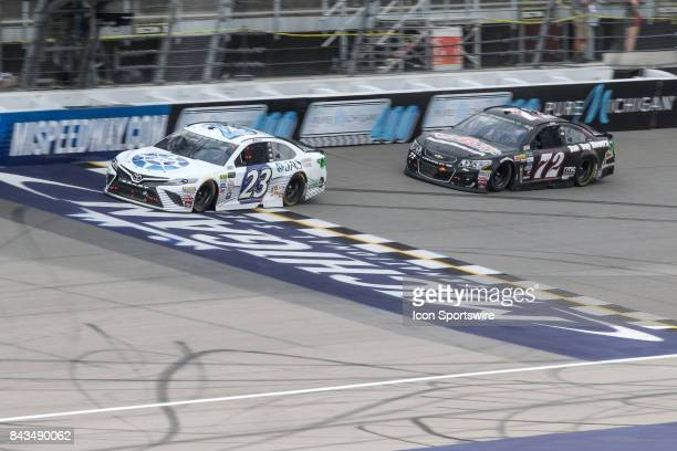 Corey LaJoie driver of the JAS Expedited Trucking Toyota and Cole Whitt driver of the Bad Boy Mowers Chevrolet race during the Monster Energy NASCAR...