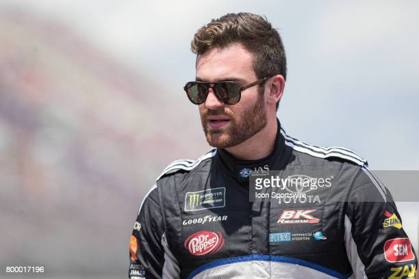 Corey LaJoie driver of the JAS Expedited Trucking Toyota greets fans during the driver introductions ceremony prior to the start of the Monster...