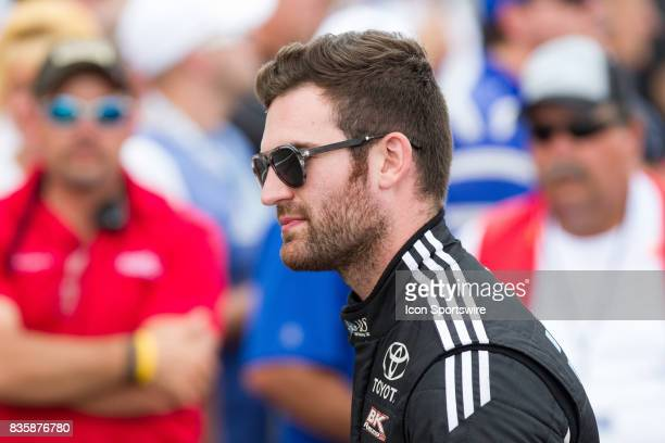 Corey LaJoie driver of the JAS Expedited Trucking Toyota greets fans during the prerace ceremonies of the Monster Energy NASCAR Cup Series Pure...