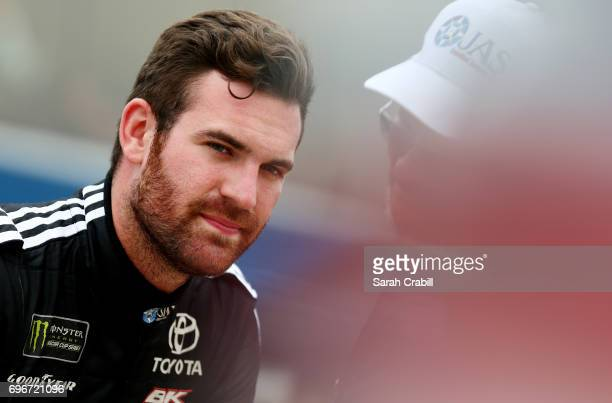 Corey LaJoie driver of the JAS Expedited Trucking Toyota sits on the wall during qualifying for the Monster Energy NASCAR Cup Series FireKeepers...