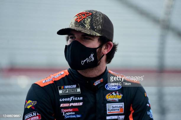 Corey LaJoie driver of the Keen Parts Ford waits on the grid prior to the NASCAR Cup Series BlueEmu Maximum Pain Relief 500 at Martinsville Speedway...