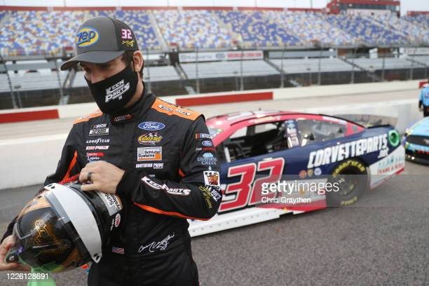 Corey LaJoie driver of the Keen Parts Thank a Hero Ford prepares for the NASCAR Cup Series Toyota 500 at Darlington Raceway on May 20 2020 in...