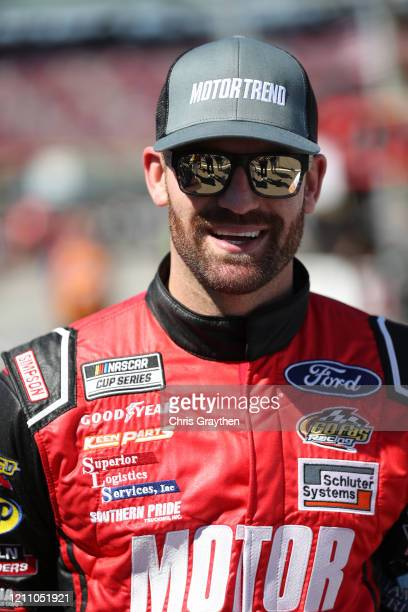 Corey LaJoie driver of the Motor Trend Ford stands on the grid during qualifying for the NASCAR Cup Series FanShield 500 at Phoenix Raceway on March...