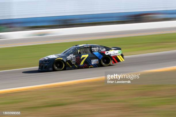 Corey LaJoie, driver of the Netflix Chevrolet, drives during the NASCAR Cup Series O'Reilly Auto Parts 253 at Daytona International Speedway on...