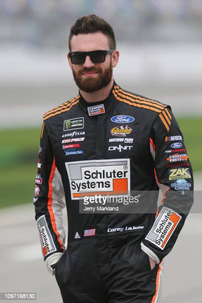 Corey LaJoie driver of the Old Spice Ford stands on the grid during qualifying for the Monster Energy NASCAR Cup Series 61st Annual Daytona 500 at...