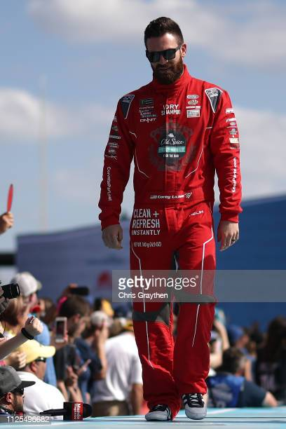 Corey LaJoie driver of the Old Spice Ford waves to fans during driver intros before the Monster Energy NASCAR Cup Series 61st Annual Daytona 500 at...