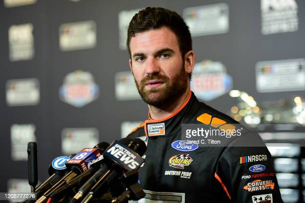 Corey LaJoie driver of the RagingBullcom Ford speaks with the media during the NASCAR Cup Series 62nd Annual Daytona 500 Media Day at Daytona...