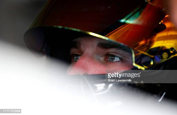 Corey LaJoie driver of the Samaritan's Feet Ford sits in his car during practice for the Monster Energy NASCAR Cup Series Bank of America ROVAL 400...
