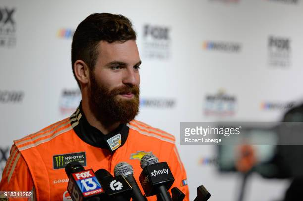 Corey LaJoie driver of the Schluter Systems Chevrolet talks to the media during the Daytona 500 Media Day at Daytona International Speedway on...