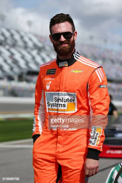 Corey LaJoie driver of the Schluter Systems Chevrolet walks on the grid during qualifying for the Monster Energy NASCAR Cup Series Daytona 500 at...