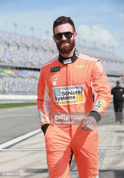 Corey LaJoie driver of the Schluter Systems Chevrolet walks to his car during qualifying for the Monster Energy NASCAR Cup Series Daytona 500 at...