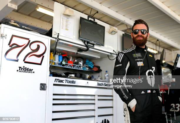 Corey LaJoie driver of the SchluterSystems Chevrolet stands in the garage area during practice for the Monster Energy NASCAR Cup Series...